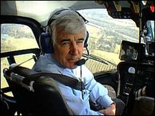 John Ware in helicopter