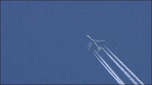 Plane leaving vapour trails in sky