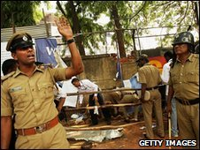Police investigate the scene of an explosion in Bangalore