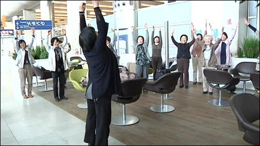 Japanese tourists stretch out in Paris airport