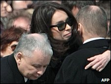 Lech Kaczynski's daughter Marta and twin Jaroslaw (front) at the service
