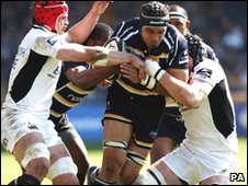 Worcester's Netani Talei is tackled by Wasps' George Skivington and Dan Ward-Smith