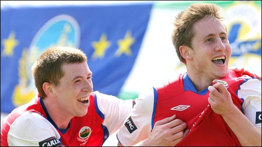 Linfield's Billy Joe Burns celebrates with Michael Carvill