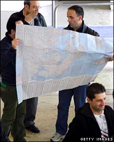 Passengers look a map of Europe at Geneva's International Airport on 18 April 18
