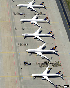 Aerial view taken on April 18, 2010 shows Lufthansa airplanes standing on the tarmac at the airport in Frankfurt