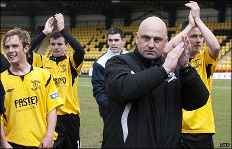 Gary Bollan celebrates with his Livingston team