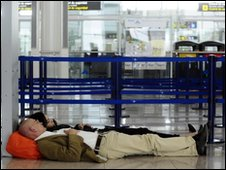 Passengers rest at the Prat Llobregat airport, near of Barcelona, Spain