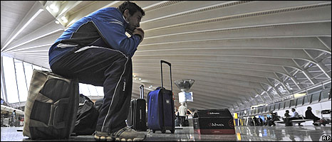 Spanish passenger sits on his baggage at Bilbao airport in northern Spain on 18/04/2010
