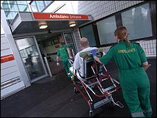 Paramedics take a patient into hospital