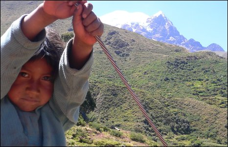 Child playing with Mount Illimani in the distance