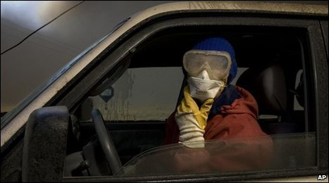 Wearing a mask and goggles, Berglind Hilmarsdottir looks for cattle lost in ash clouds in Nupur, Iceland, 17 April 2010