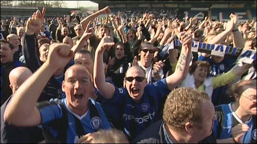 Rochdale supporters celebrate at Spotland
