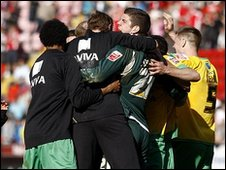 Norwich City players celebrate promotion after their win over Charlton.