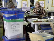 Electoral workers at a vote counting centre in Baghdad  14 March 2010