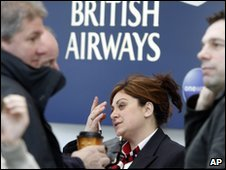BA employee talks to passengers at O'Hare International Airport in Chicago