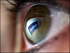 Facebook reflected in eyeball, Getty