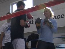 Martina gloved up in the ring