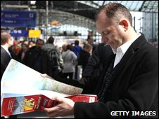 A man looks at a map of Europe at Hauptbahnhof train station in Berlin,