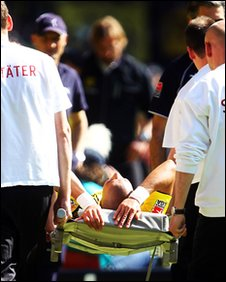 Mohamed Zidan is carried off after being injured for his club Borussia Dortmund