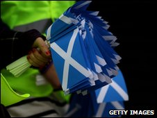 SNP activists carrying saltires