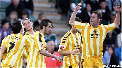 Kevin Nolan (right) and team-mates celebrate Newcastle goal