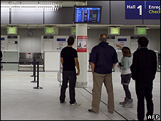 Passengers waiting at Orly airport, near Paris, 20 Apr 10