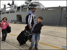 A British family boards HMS Albion at Santander on 20 April 2010