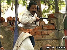 A security expert investigates damage caused by one of the blasts