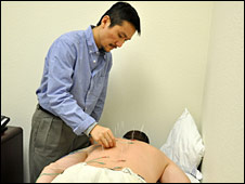 A doctor performs acupuncture on a soldier at the Warrior Combat Stress Reset Centre at Fort Hood
