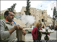 Man smoking water pipe in Aleppo, Syria