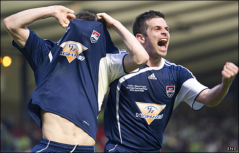 Martin Scott (left) celebrates Ross County's second goal against Celtic with Steven Craig