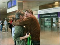 A couple embrace after being reunited at Boston's Logan International Airport, following the arrival of a Lufthansa flight from Frankfurt, 20 April
