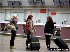Passengers wait at Glasgow Airport