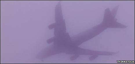 Plane flying through mist