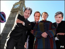 Baroness Valentine and three supporters wearing masks of Nick Clegg, David Cameron and Gordon Brown