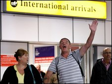 Passengers arrive home