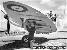 Mechanic rearming Spitfire, 1940