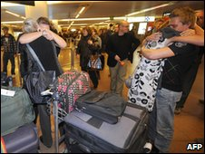 Belgian tourists who were evacuated by the Belgian Army and Belgian airlines company SN Brussels embrace relatives as they arrive in Zaventem airport on April 21, 2010, in Belgium.