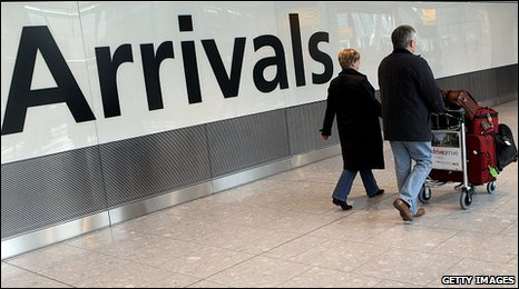 "A couple arrive in Heathrow airport""s Terminal 5 on April 21, 2010 in London, England. Airlines are beginning to resume a normal service following six days of airport closures due to volcanic ash from Iceland covering British airspace."