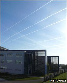 Met Office headquarters with plane contrails in the background