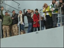 The service personnel and tourists arriving home on board HMS Albion