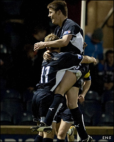 Raith Rovers' Dougie Hill (top) is hoisted high in the air in celebration of his opener