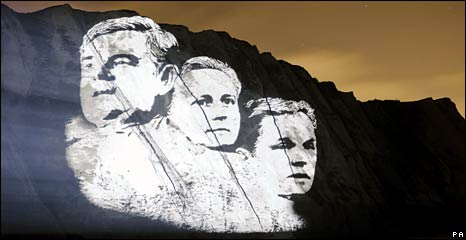 Gordon Brown, David Cameron and Nick Clegg projected onto the White Cliffs of Dover by Sky News