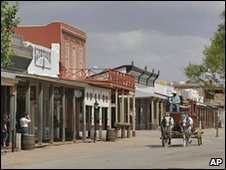 A stagecoach rolls through Tombstone, Arizona
