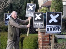 Robin Howell with his Vote Against Greed poster