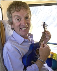 Frank Skinner playing the ukulele