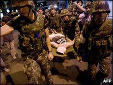 Injured protester is taken away