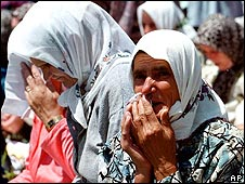 Bosnian women weep at memorial service for victims of Srebrenica massacre