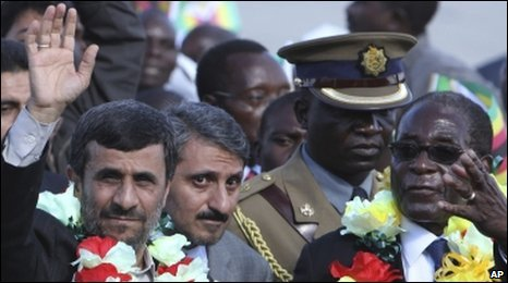 Iranian President Mahmoud Ahmadinejad beside Zimbabwean President Robert Mugabe upon the former's arrival at Harare airport, 22 April 2010