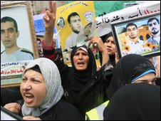 Women demonstrate against the arrest of their husbands in Gaza